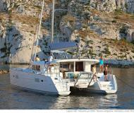 Catamaran Lagoon 400 S2 available for charter in Skiathos main Harbour