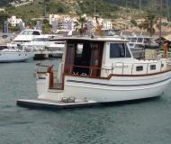 Motor boat Menorquin 100 available for charter in Port d Aiguadolc