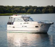 Motor yacht Nautika 1000 available for charter in Wilkasy Marina